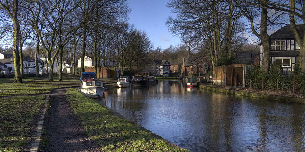Houses and canal with trees
